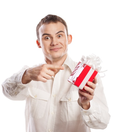 portrait of smiling man pointing on gift isolated on white background Stock Photo - 12511692