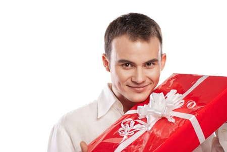 portrait of smiling man holding gift isolated on white background Stock Photo - 12511700