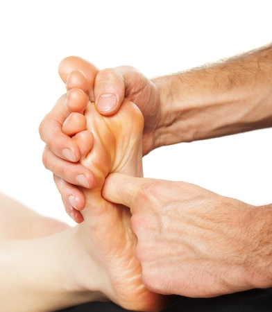 Closeup of foot receiving massage on white Stock Photo - 12946584