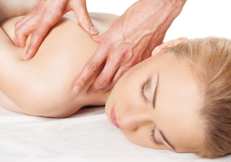 girl getting a massage - hands massaging her back - A pretty woman getting a shoulder and back massage Stock Photo - 12899950