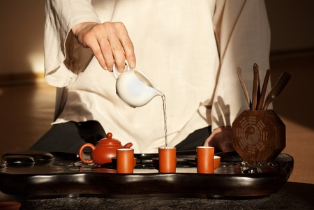 tea hot drink: Chinese tea ceremony is perfomed by tea master in kimono Stock Photo