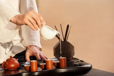 chinese tea cup: Chinese tea ceremony is perfomed by tea master in kimono Stock Photo