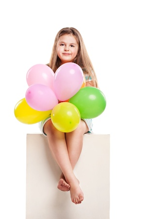 Isolated studio picture from a little girl with balloons photo