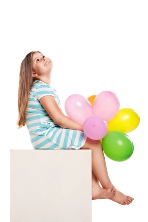 Happy girl with balloons on a white background photo