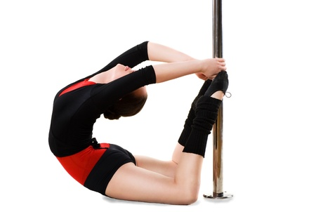 Young pole dance woman doing gymnastics against a white background photo