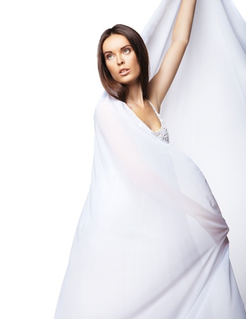 Romantic beautiful woman wearing white dress isolated