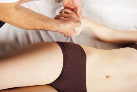 girl getting a massage - hands massaging her hand - A pretty woman getting a hand massage Stock Photo - 15712927