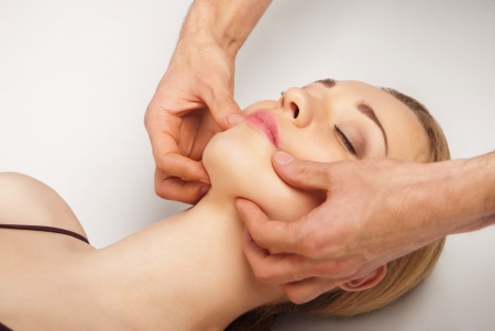 Young bright woman receiving a head massage in a spa centre Stock Photo - 16986931