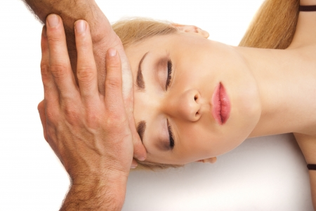 Young bright woman receiving a head massage in a spa centre Stock Photo - 16986933