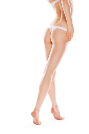 Rear view of beautiful caucasian woman with long legs, isolated on white background Stock Photo