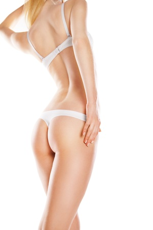 cintura perfecta: Vista trasera de una mujer caucásica hermosa en bikini blanco, aislados en fondo blanco