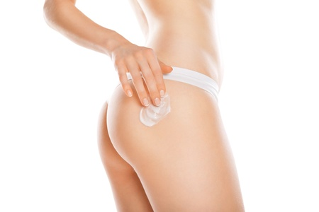 Woman applying moisturizer cream on legs  Perfect female figure Stock Photo - 16569342