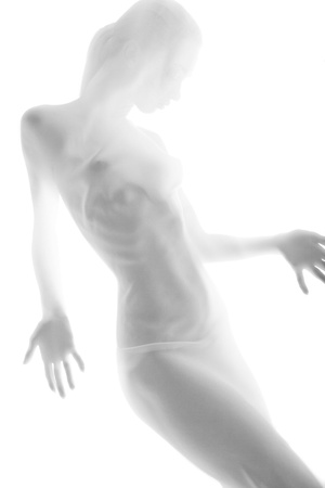 nude female body model: The body of a beautiful naked woman through the transparent fabric on a light background
