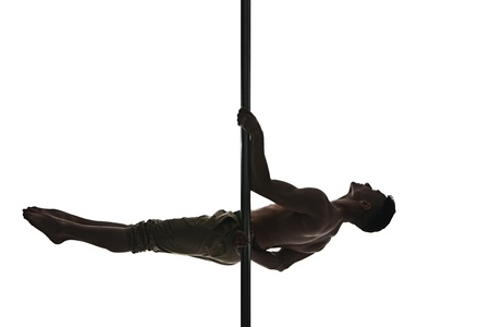 Young strong pole dance man isolated over white background photo