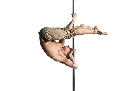 strip dance: Young strong pole dance man isolated over white background