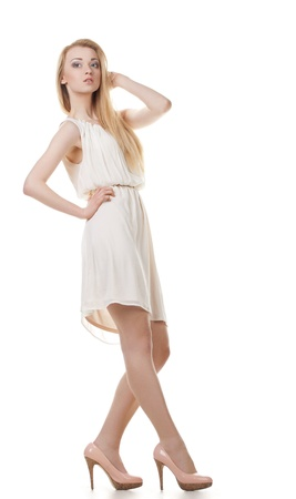 Portrait of beautyful smiling and posing blond woman with long hair on white background photo