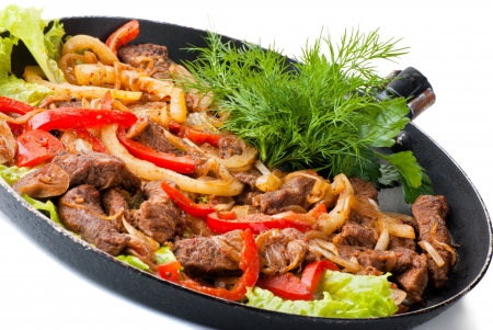 traditional mexican beef fajitas on white background photo