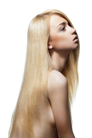 Well-being & spa. Sensual woman model with shiny straight long blond hair. Health, beauty, wellness, haircare, cosmetics and make-up photo