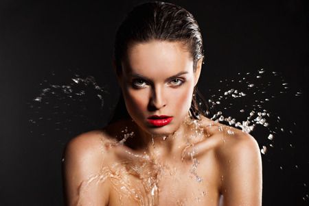 Portrait of young sensuality beautiful woman under the stream of water  photo