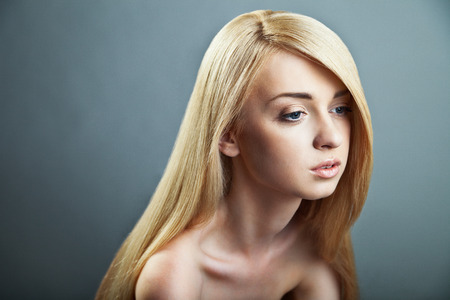 Sensual woman model with shiny straight long blond hair.  photo
