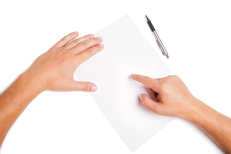 Close-up man hands pointing on white blank with pen Isolated photo
