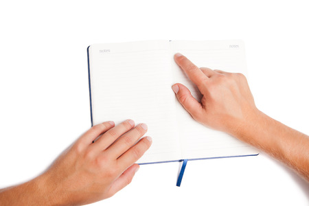 Man hand holding open book and pointing isolated on white background photo