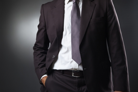businessman in suit on gray background photo