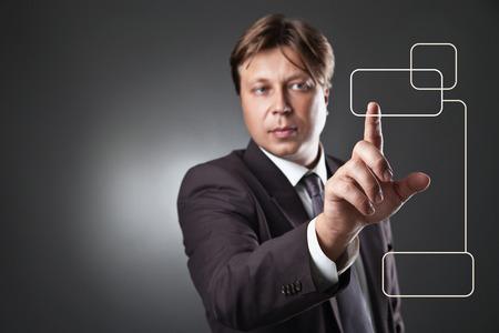 Businessman pressing copyspace sensor square key over dark photo