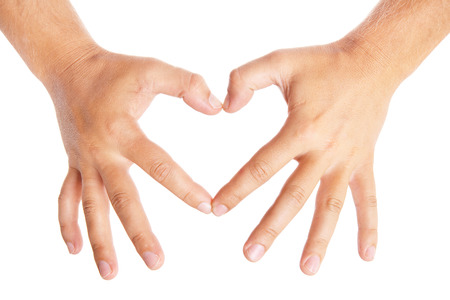 hands forming a heart on white background photo