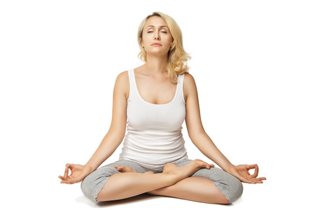 Young woman doing yoga isolated against white background