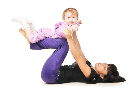 Yoga for woman and child. Mother with the baby doing exercises Stock Photo - 27011303