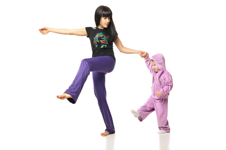 Yoga for woman and child. Mother with the baby doing exercises photo