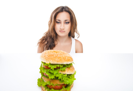 picture of healthy woman rejecting junk food isolated over white background photo