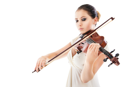 Beautiful young woman playing violin over white background Stock Photo