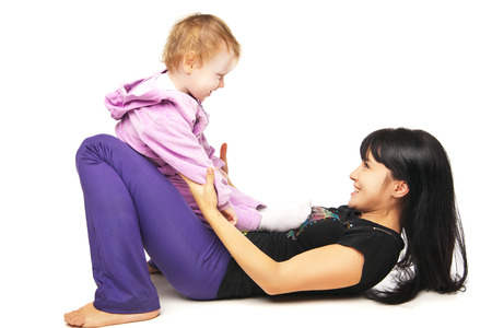 Yoga for woman and child. Mother with the baby doing exercises Stock Photo - 27011651