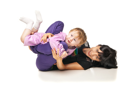 Yoga for woman and child. Mother with the baby doing exercises Stock Photo - 27011787