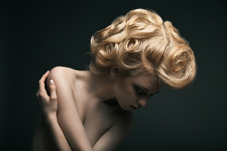 Beautiful high fashion female model with abstract hair style  photo