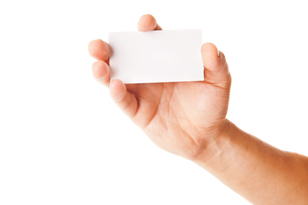 Business card in man's hand on white background photo