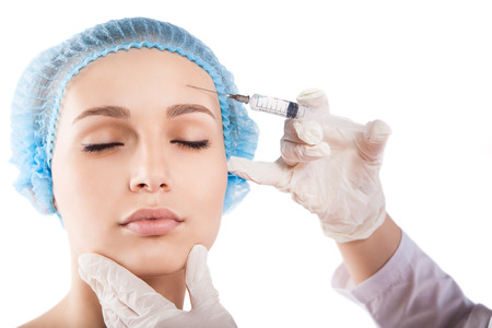 pretty woman face: Cosmetic injection to the pretty woman face isolated over white Stock Photo