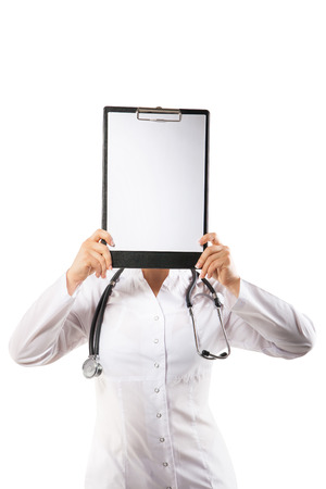 Young cheerful woman doctor is showing her blank tablet photo