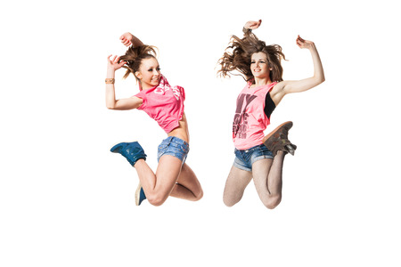 cool looking two dancing women isolated on white background photo