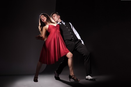 tango: Man and woman in the most romantic dance tango over dark background