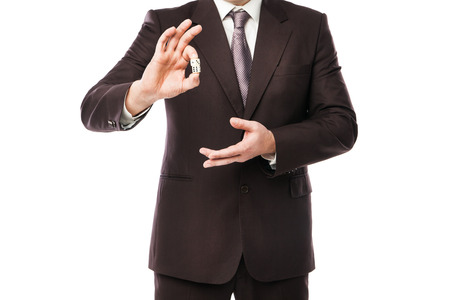 Business risk concept - businessman in suit throwing dices isolated on white background photo