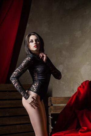 Portrait of sensual brunette woman wearing sexy black lingerie , posing photo