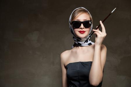 young stylish caucasian woman posing, over dark , retro styling photo