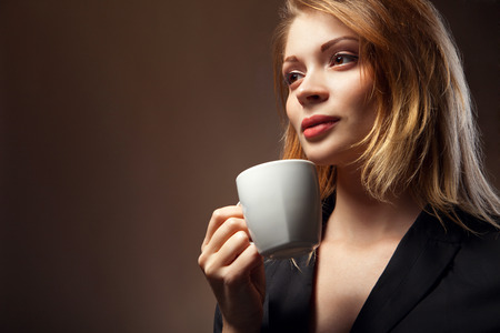 Coffee  Beautiful Girl Drinking Tea or Coffee  Cup of Hot Beverage photo