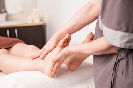 reflexology: Foot massage for a woman in a luxury spa Stock Photo