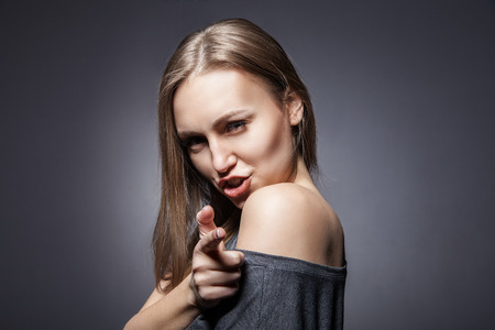 Young Beautiful Woman pretending to shoot with her finger photo