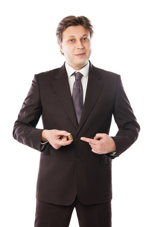 businessman holding coins in his hand isolated over white
