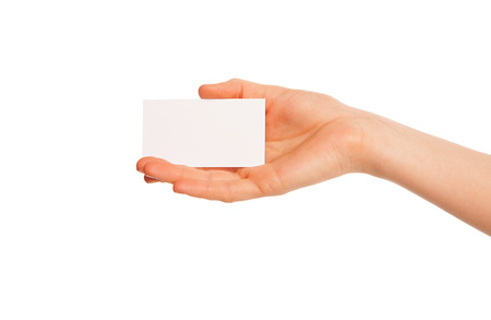 one hand holding a white piece of cardboard. Hand to left. photo
